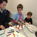 Children building their own LEGOscope at the Imperial Festival 2018